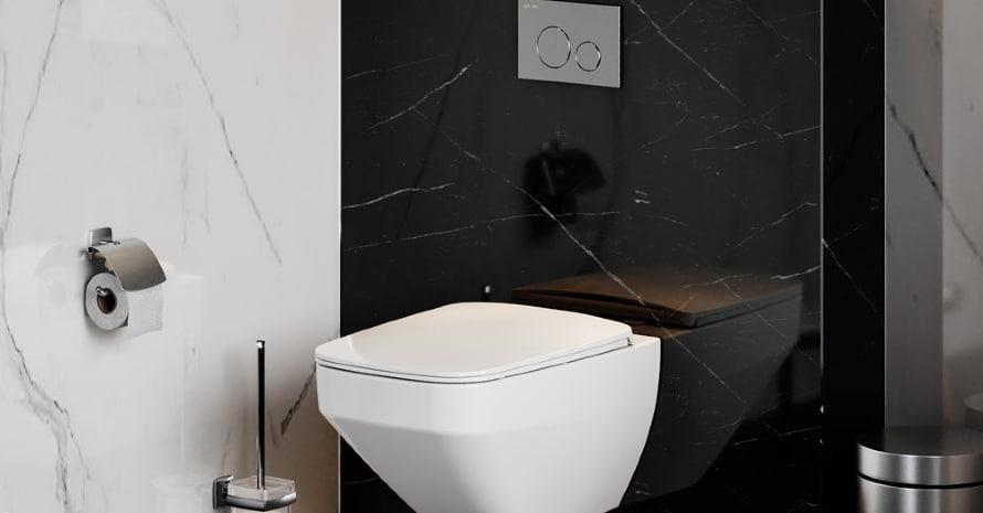 Toilet bowl on black tiles background
